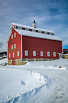 Winter snow blankets a restored monitor barn, now the headquarters of the Vermont Youth Conservation Corps  in Richmond, VT