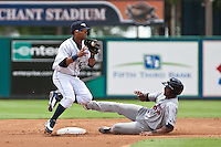 Gustavo Nunez (24) of the Lakeland Flying Tigers tries to turn a Double Play as Deibinson Romero of the Miracle slides into second. During a game vs. the Ft. Myers Miracle June 6 2010 at Joker Marchant Stadium in Lakeland, Florida. Ft. Myers won the game against Lakeland by the score of 2-0.  Photo By Scott Jontes/Four Seam Images