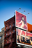 USA, New York, a red building in Soho with a billboard of a beautiful woman, New York City