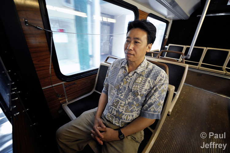 Hieu Van Bui, a Vietnamese survivor of human trafficking, rides a bus through Honolulu, Hawaii. He has received assistance from the Susannah Wesley Community Center, which has played a key role in identifying and supporting victims of trafficking in Hawaii.