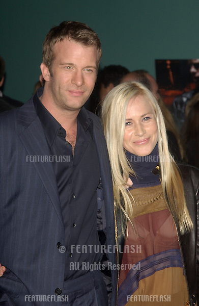 Actor THOMAS JANE & fiancée actress PATRICIA ARQUETTE at the Los Angeles premiere of his new movie The Punisher..April 12, 2004