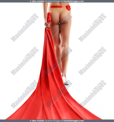 Beautiful naked woman walking with red silk flowing behind her back. Isolated silhouette on white background