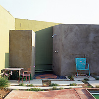 An open-air shower by the side of the outdoor swimming pool