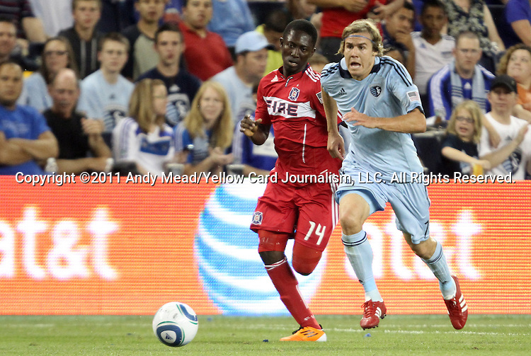 09 June 2011: Chicago's Patrick Nyarko (GHA) (14) and Kansas City's Chance Myers (7). Sporting Kansas City played the Chicago Fire to a 0-0 tie in the inaugural game at LIVESTRONG Sporting Park in Kansas City, Kansas in a 2011 regular season Major League Soccer game.