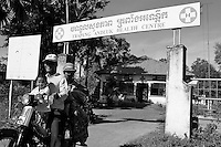 Health center Cambodia. A family is leaving Trapeng Andeuk health center riding a moto. In Ang Roka district live mainly small shop owners and farmers. Trapeng Andeuk, Takeo province, Cambodia-2009