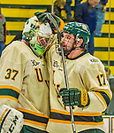 14 December 2013: University of Vermont Catamount Forward Jake Fallon, a Junior from Southlake, Texas, congratulates Goaltender Brody Hoffman, a Sophomore from Wilkie, Saskatchewan, after the final play against the Saint Lawrence University Saints at Gutterson Fieldhouse in Burlington, Vermont. The Catamounts defeated their former ECAC rivals, 5-1 to notch their 5th straight win in NCAA non-divisional play. Mandatory Credit: Ed Wolfstein Photo *** RAW (NEF) Image File Available ***