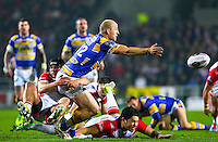 Picture by Alex Whitehead/SWpix.com - 28/03/2014 - Rugby League - First Utility Super League - St Helens v Leeds Rhinos - Langtree Park , St Helens, England - Leeds' Carl Ablett is tackled by St Helens' Jonny Lomax.