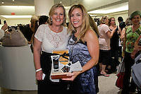 Woman wins Menaji Mens skincare products, from raffle at The Plaza Hotel's Fashion's Night Out event during New York Fashion Week, September 8, 2011.