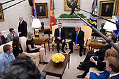 U.S. President Donald Trump meets with Pastor Andrew Brunson in the Oval Office of the White House on October 13, 2018 in Washington, DC. Pastor Andrew Brunson arrived back in the U.S. on Saturday after being held in Turkey for two years on terrorism charges. <br /> Credit: Olivier Douliery / Pool via CNP