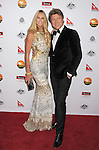 LOS ANGELES, CA - JANUARY 12: Elle MacPherson and Richard Wilkins attend the 2013 G'Day USA Black Tie Gala at JW Marriott Los Angeles at L.A. LIVE on January 12, 2013 in Los Angeles, California.