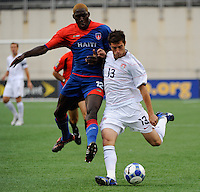 Colin Clark (13) of the United States (USA) is defended by James Marcelin (12) of Haiti (HAI). The United States and Haiti played to a 2-2 tie during a CONCACAF Gold Cup Group B group stage match at Gillette Stadium in Foxborough, MA, on July 11, 2009. .