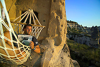 Goreme, Cappadocia, Turkey, July 2005. Dutch Frits takes a break in the Hammock. Photographer Frits Meyst and his wife Jillian Macdonald restored an old rock house in the village of Goreme. Since Roman Times people have been cutting graves and home out of the Soft tufo 'Fairy Chmney' rocks of Cappadocia. Photo by Frits Meyst / MeystPhoto.com