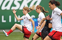 Portland, Oregon - Wednesday June 22, 2016: Portland Thorns FC defender Emily Sonnett (16) and midfielder Lindsey Horan (7) prior to a regular season National Women's Soccer League (NWSL) match at Providence Park.