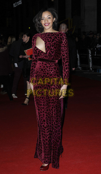 "Amal Fashanu.attended the ""Arbitrage"" UK film premiere, Odeon West End cinema, Leicester Square, London, England, UK, February 20th 2013..full length pink red cut out leopard print dress long sleeve maxi  shoes burgundy .CAP/CAN.©Can Nguyen/Capital Pictures."