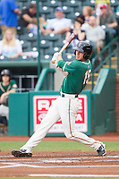J.T. Riddle (15) of the Greensboro Grasshoppers follows through on his swing against the Hagerstown Suns at NewBridge Bank Park on May 20, 2014 in Greensboro, North Carolina.  The Grasshoppers defeated the Suns 5-4. (Brian Westerholt/Four Seam Images)