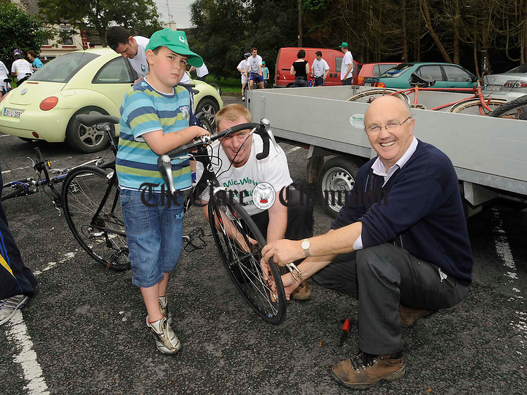 Ronan Lillis gets his bike prepared by his dad Frankie and Brendan Marrinan before taking part in the 5th annual Michael Garry Memorial Cycle at Cooraclare in aid of five local charities. Photograph  by John Kelly.