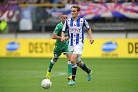 VOETBAL: HEERENVEEN: 15-09-2013,  Abe Lenstra Stadion, SC Heerenveen-FC Groningen, Magnus Eikrem, ©foto Martin de Jong