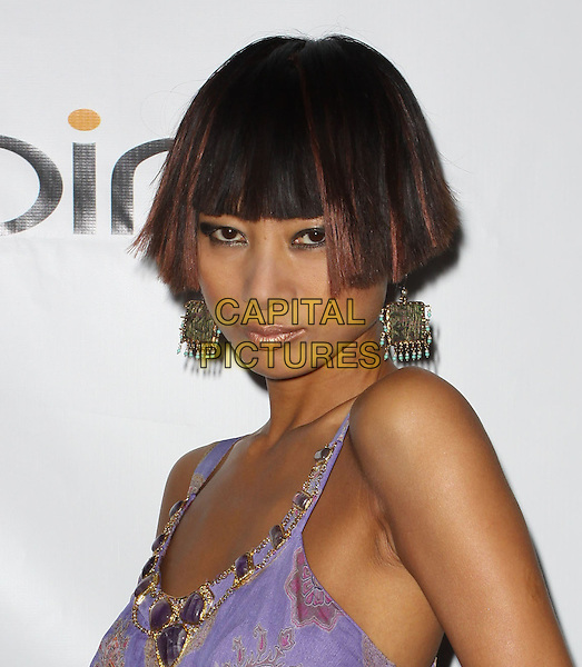 BAI LING .40th Annivesary of Earth Day held At The JW Marriott LA Live, Los Angeles, California, USA, 22nd April 2010..portrait headshot dangly purple lilac print bob fringe earrings .CAP/ADM/KB.©Kevan Brooks/AdMedia/Capital Pictures.