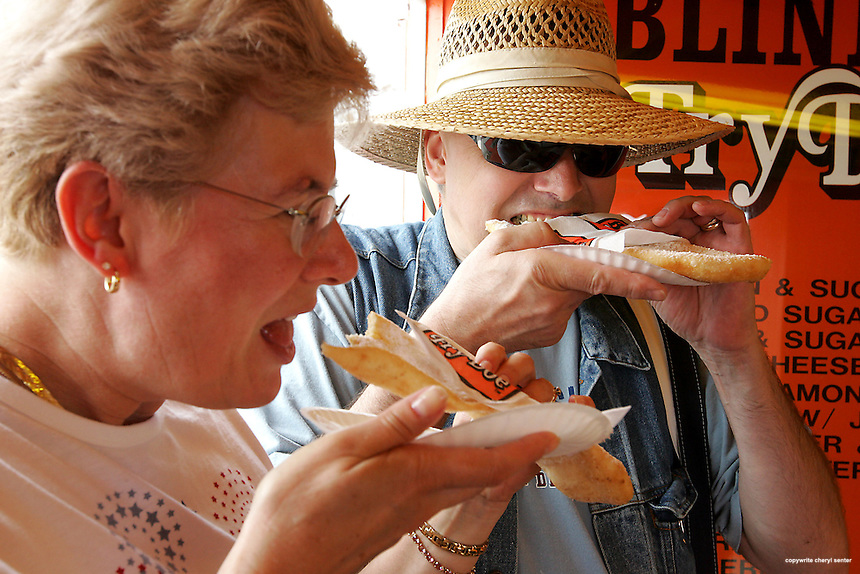 Enjoying a bite at Blinks Fried Dough are John and Bozena Toczydlowski of North Hampton at Hampton Beach, Hampton, N.H. Sunday, August 10, 2008.  (Portsmouth Herald Photo/Cheryl Senter)