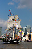 London, UK. 9 September 2014. Tall ships gathering near Canary Wharf. The Tall Ships that have taken part in the Royal Greenwich Tall Ships Festival 2014 leave Greenwich in a Parade of Sail down the River Thames. Photo: Bettina Strenske