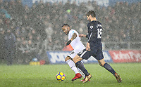 Jordan Ayew of Swansea City  moves from Fernando Llorente of Spurs during the Premier League match between Swansea City and Tottenham Hotspur at the Liberty Stadium, Swansea, Wales on 2 January 2018. Photo by Mark Hawkins / PRiME Media Images.