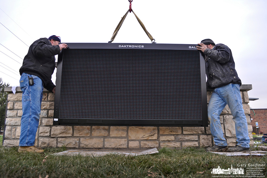 Workers install an electronic full color sign at the Blendon Township Senior Center. The new sign replaces the roadside yellow plastic portable sign the center has used for years to make announcements. It was paid for with the money the center raised with its bake sales, events, and fund raisers.
