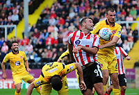 Lincoln City's Matt Rhead vies for possession with Morecambe's Dean Winnard<br /> <br /> Photographer Andrew Vaughan/CameraSport<br /> <br /> The EFL Sky Bet League Two - Lincoln City v Morecambe - Saturday August 12th 2017 - Sincil Bank - Lincoln<br /> <br /> World Copyright &copy; 2017 CameraSport. All rights reserved. 43 Linden Ave. Countesthorpe. Leicester. England. LE8 5PG - Tel: +44 (0) 116 277 4147 - admin@camerasport.com - www.camerasport.com