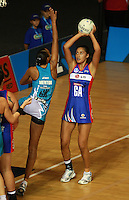 20.03.2010 Mystics Maria Tutaia and Thunderbirds Geva Mentor in action during the ANZ Champs Netball match between the Mystics and Thunderbirds at Trusts Stadium in Auckland. Mandatory Photo Credit ©Michael Bradley.