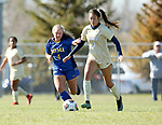BROOKINGS, SD, OCTOBER 21: Kaitlin Zabel #4 from South Dakota State battles for the ball with Shayla Padilla #7 from Oral Roberts during their match Sunday afternoon at Fischback Soccer Field in Brookings. (Dave Eggen/Inertia)