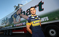 PICTURE BY VAUGHN RIDLEY/SWPIX.COM - Rugby League - Super League - Stobart Super League 2012 Season Launch - Old Trafford, Manchester, England - 01/02/12 - Leeds Kevin Sinfield and the Leeds Stobart truck in the car park outside Old Trafford during the Stobart Super League 2012 season launch.