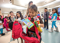NWA Media/JASON IVESTER --12/03/2014--<br /> Jones Elementary second-grader Maritza (cq) Diaz looks through the supplies in her new backpack on Wednesday, Dec. 3, 2014, at the Rogers school. The Kids in Need Foundation provided backpacks filled with school supplies to every child at Russell D. Jones and Old Wire Elementary School.
