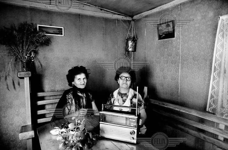 Two sisters with their radio in the bar they run in a disused container next to the highway between Dilijan and Lake Sevan.