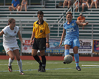 Seacoast United Mariners midfielder Krista Hagen (14) traps the ball as Boston Aztec defender Jessica Morrow (26) closes. In a Women's Premier Soccer League (WPSL) match, Boston Aztec (white) defeated Seacoast United Mariners (blue), 2-1, at North Reading High School Stadium on Arthur J. Kenney Athletic Field on on June 23, 2013. Due to injuries through the season, Seacoast United Mariners could only field 10 players.