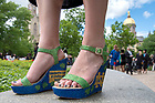 May 21, 2017; Graduate Emily Carson wears custom-decorated shoes made by her younger sister for Commencement 2017. (Photo by Matt Cashore/University of Notre Dame)