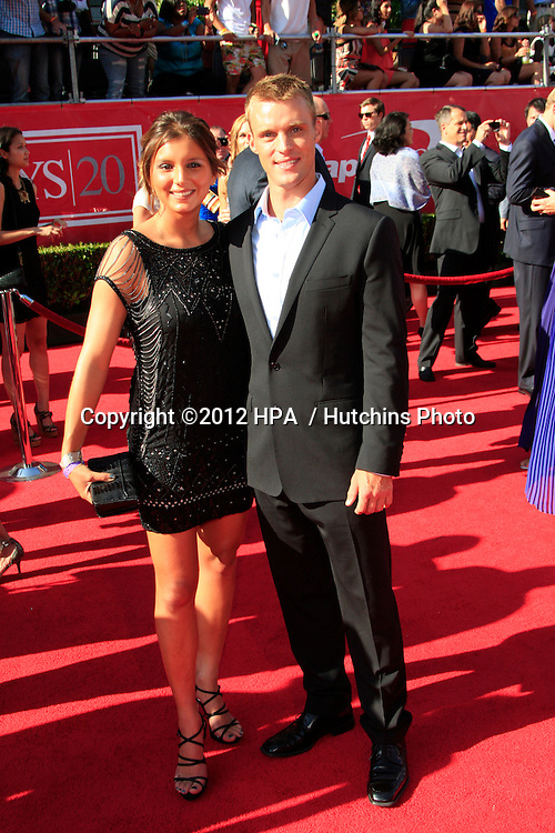 LOS ANGELES - JUL 11:  Jesse Spencer, Maya Gabeira arrives at the 2012 ESPY Awards at Nokia Theater at LA Live on July 11, 2012 in Los Angeles, CA