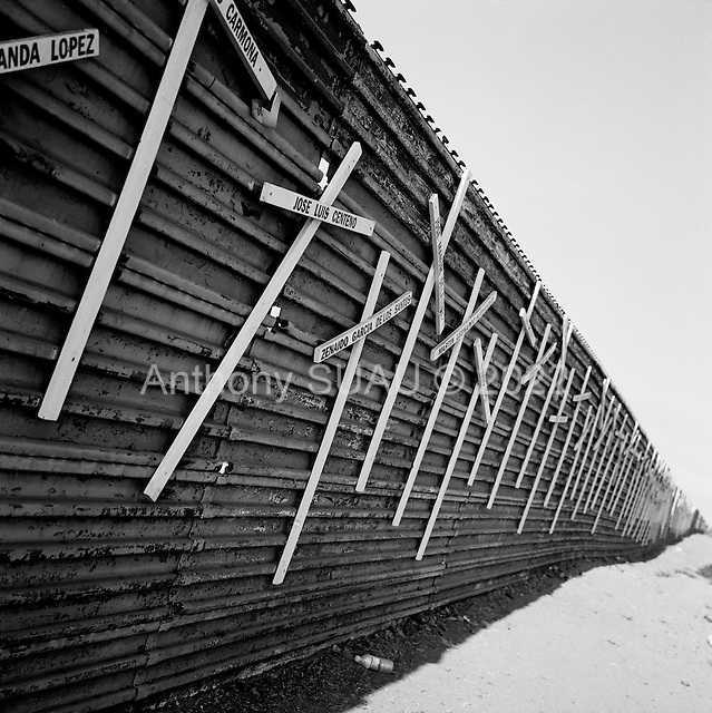 Tijuana, Mexico<br /> August 18, 2007<br /> <br /> The Mexican US border fence on the Mexican side is covered in memorials for the hundreds who have died attempting to cross the border.