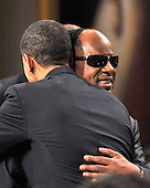 "Washington, D.C. - February 25, 2009 -- United States President Barack Obama hugs Stevie Wonder as he and first lady Michelle Obama host ""Stevie Wonder In Performance at the White House: The Library of Congress Gershwin Prize"" to showcase an evening of celebration at the White House in honor of musician Stevie Wonder's receipt of the Library of Congress Gershwin Prize for Popular Song in the East Room of the White House in Washington, D.C. on Wednesday, February 25, 2009..Credit: Ron Sachs / Pool via CNP"