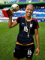 USWNT midfielder (16) Angela Hucles holds the trophy for most valuable player, the golden ball, after the finals of the Peace Queen Cup.  The USWNT defeated Canada, 1-0, at Suwon World Cup Stadium in Suwon, South Korea.