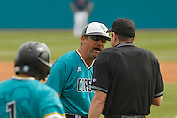 University of Coastal Carolina Chanticleers Head Coach Gary Gilmore (14)  arguing a call during a game against the University of Virginia Cavaliers at Springs Brooks Stadium on February 21, 2016 in Conway, South Carolina. Coastal Carolina defeated Virginia 5-4. (Robert Gurganus/Four Seam Images)