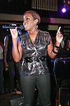 Estelle signs at the 360 Induced Executive Mixer, hosted by Ne-Yo at Millesime NYC, January 19, 2011.