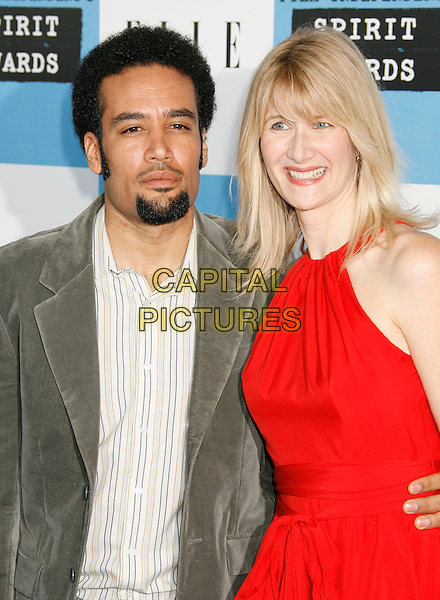 BEN HARPER & LAURA DERN .The 2007 Independent Spirit Awards held at the Santa Monica Pier, Santa Monica, California, USA..February 24th, 2007.half length goatee facial hair grey gray couple dress red.CAP/ADM/RE.©Russ Elliot/AdMedia/Capital Pictures