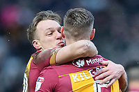 Tony McMahon of Bradford City plants a kiss on Matt Kilgallon of Bradford City after he scores the first goal of the game for Bradford City during the Sky Bet League 1 match between Bradford City and Rochdale at the Northern Commercial Stadium, Bradford, England on 9 December 2017. Photo by Thomas Gadd.