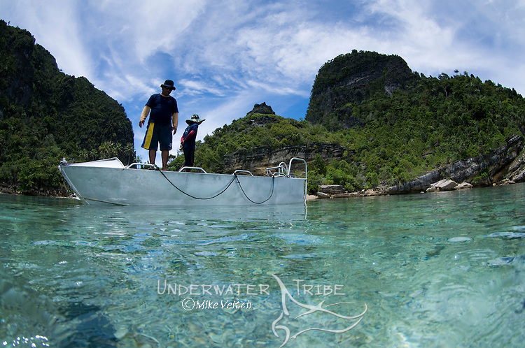 Two men on a boat, Split level photo, Misool area, Raja Ampat, West Papua, Indonesia, Pacific Ocean