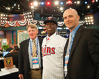 Infielder Nick Gordon (Olympia H.S. (FL)) the number 5 overall pick to the Minnesota Twins with Twins representatives John Wilson and Corey Koskie during the MLB Draft on Thursday June 05,2014 at Studio 42 in Secaucus, NJ.   (Tomasso DeRosa/ Four Seam Images)