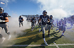 The Nevada football team takes the field before their NCAA college football game against San Jose State in Reno, Nev. Saturday, Nov. 11, 2017. (AP Photo/Tom R. Smedes)