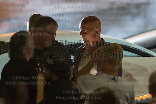 US actor Bruce Willis on set during a shooting of his next movie fifth in the Die Hard series titled Good Day to Die Hard in Budapest, Hungary on July 10, 2012. ATTILA VOLGYI
