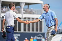 Sam Ryder (USA) shakes hands with Matt Kuchar (USA) on 18 following round 4 of the Houston Open, Golf Club of Houston, Houston, Texas. 4/1/2018.<br /> Picture: Golffile | Ken Murray<br /> <br /> <br /> All photo usage must carry mandatory copyright credit (&copy; Golffile | Ken Murray)