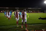 Home players making their way from the pitch at Aggborough, home of Kidderminster Harriers (in red) after they played visitors Gainsborough Trinity in a National League North fixture. Harriers were formed in 1886 and have played at their current home since 1890. They won this match  by 3-0 watched by a crowd of 1465.