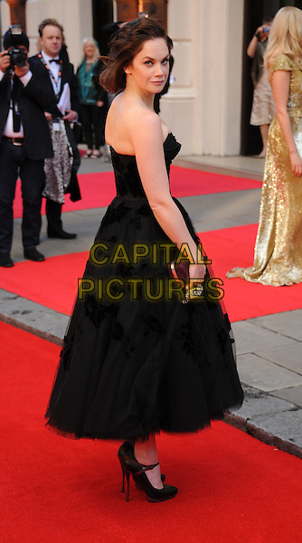 Ruth Wilson.The Olivier Awards 2012, Royal Opera House, Covent Garden, London, England..April 15th, 2012.full length dress side looking over shoulder black strapless.CAP/WIZ.© Wizard/Capital Pictures.