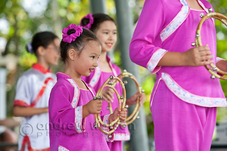 Young Chinesee dancer at the Tropical Wave Festival.  The festival held in August, celebrates the region's multicultural mix.  Cairns, Queensland, Australia